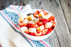 Oatmeal with poppy seeds, raisins, strawberries and banana Stock Photos
