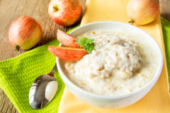 Oatmeal porridge with apple Stock Images