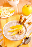 Oatmeal porridge with apple, nuts and cinnamon Royalty Free Stock Image