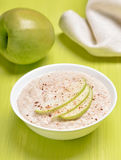 Oatmeal porridge with apple slices Stock Photos
