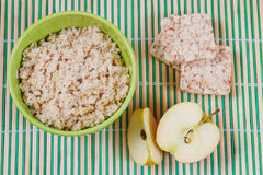 Oatmeal Porridge with Apple Slices in Green Bowl Stock Photos