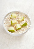 Oatmeal porridge with apple slices Royalty Free Stock Photo