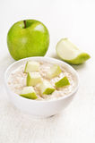 Oatmeal porridge with apple slices Royalty Free Stock Photography