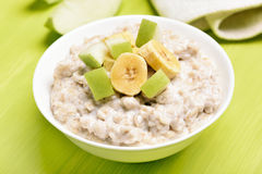 Oatmeal porridge with apples and bananas Stock Image