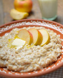 Oatmeal porridge with apples Stock Images
