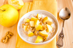 Oatmeal porridge with apples, nuts Royalty Free Stock Image