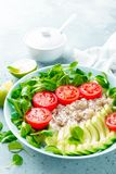Oatmeal porridge with avocado and vegetable salad of fresh tomatoes and lettuce. Healthy dietary breakfast. Closeup royalty free stock photo