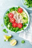 Oatmeal porridge with avocado and vegetable salad of fresh tomatoes and lettuce. Healthy dietary breakfast. Closeup stock photography