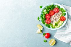 Oatmeal porridge with avocado and vegetable salad of fresh tomatoes and lettuce. Healthy dietary breakfast. Top view royalty free stock photography