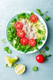 Oatmeal porridge with avocado and vegetable salad of fresh tomatoes and lettuce. Healthy dietary breakfast. Top view stock photo