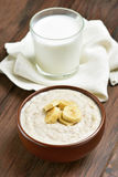 Oatmeal porridge with banana slices Royalty Free Stock Image