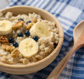 Oatmeal porridge with bananas, blueberries Stock Photography