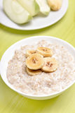 Oatmeal porridge with bananas slices Royalty Free Stock Image