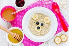 Oatmeal porridge bear with honey banana and berries, fun food ar Royalty Free Stock Photography