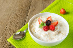 Oatmeal porridge with berries Stock Photography
