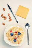 Oatmeal porridge with berries and nuts in bowl, top view Stock Image
