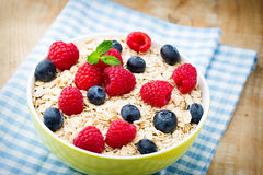 Oatmeal porridge with berries. Raspberries and blueberries. Oatmeal porridge with berries. Raspberries and blueberries Royalty Free Stock Photo