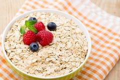 Oatmeal porridge with berries. Raspberries and blueberries. Royalty Free Stock Photos