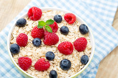 Oatmeal porridge with berries. Raspberries and blueberries. Oatmeal porridge with berries.  Raspberries and blueberries Royalty Free Stock Photos