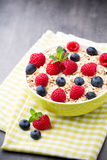 Oatmeal porridge with berries. Raspberries and blueberries. Stock Images