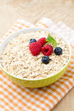 Oatmeal porridge with berries. Raspberries and blueberries. Royalty Free Stock Images