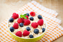 Oatmeal porridge with berries. Raspberries and blueberries. Oatmeal porridge with berries. Raspberries and blueberries Stock Image