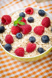 Oatmeal porridge with berries. Raspberries and blueberries. Royalty Free Stock Image