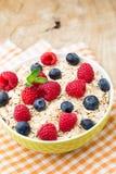 Oatmeal porridge with berries. Raspberries and blueberries. Oatmeal porridge with berries.  Raspberries and blueberries Royalty Free Stock Image
