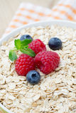 Oatmeal porridge with berries. Raspberries and blueberries. Oatmeal porridge with berries. Raspberries and blueberries Royalty Free Stock Images