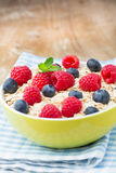 Oatmeal porridge with berries. Raspberries and blueberries. Oatmeal porridge with berries. Raspberries and blueberries Stock Photography