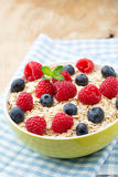 Oatmeal porridge with berries. Raspberries and blueberries. Oatmeal porridge with berries. Raspberries and blueberries Royalty Free Stock Image