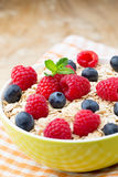 Oatmeal porridge with berries. Raspberries and blueberries. Oatmeal porridge with berries. Raspberries and blueberries Royalty Free Stock Photography
