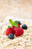 Oatmeal porridge with berries. Raspberries and blueberries. Stock Image