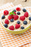 Oatmeal porridge with berries. Raspberries and blueberries. Stock Photos