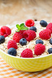 Oatmeal porridge with berries. Raspberries and blueberries. Royalty Free Stock Photography