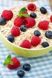 Oatmeal porridge with berries. Raspberries and blueberries. Royalty Free Stock Photo