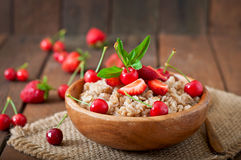 Oatmeal porridge with berries Stock Images