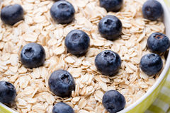 Oatmeal porridge with blueberries. healthy breakfast Stock Image