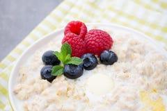 Oatmeal porridge in bowl with berries raspberries and blackberri Royalty Free Stock Image