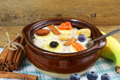 Oatmeal porridge in bowl topping with banana cinnamon blueberry dry fruit Royalty Free Stock Photography