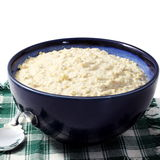 Oatmeal porridge in bowl in white background Stock Photos