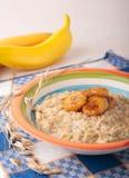 Oatmeal porridge with caramelized banana Royalty Free Stock Images