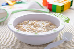 Oatmeal porridge for children nutrition on white tablecloth Stock Images