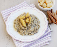 Oatmeal Porridge with Cinnamon and Caramelized Apples Royalty Free Stock Images