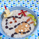 Oatmeal porridge decorated with treasure map. Oatmeal porridge decorated with a fruity treasure map Royalty Free Stock Photo