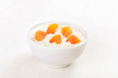 Oatmeal porridge with dried apricots Royalty Free Stock Photography