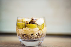 Oatmeal porridge flavored with mashed banana, topped with sliced Stock Image