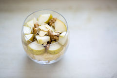 Oatmeal porridge flavored with mashed banana, topped with sliced Royalty Free Stock Photography