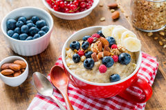 Oatmeal porridge with fresh berries, fruits and nuts Royalty Free Stock Photo