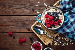 Oatmeal porridge with fresh berries, oats with blueberry and raspberry Stock Photo